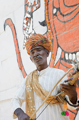 Photograph - Portrait Of A Musician Playing A by Exotica.im