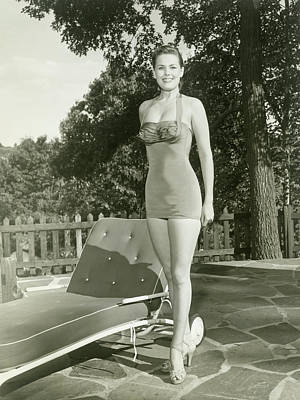 Lounge Chair Photograph - Portrait Of Young Woman By Lounge Chair by George Marks