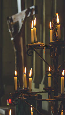 Photograph - Prayer Candles In Front Of Blurred Jesus On The Cross by Jacek Wojnarowski