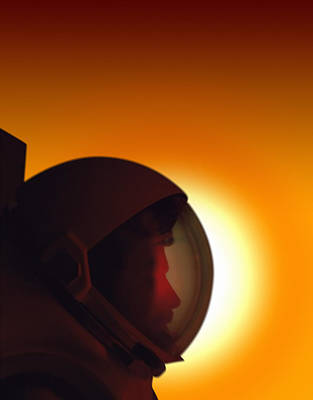 Photograph - Profile Of A Helmeted Astronaut Against by Photodisc