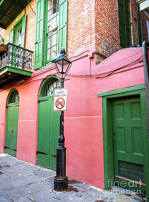 Photograph - Quiet Zone At Pirate Alley New Orleans by John Rizzuto