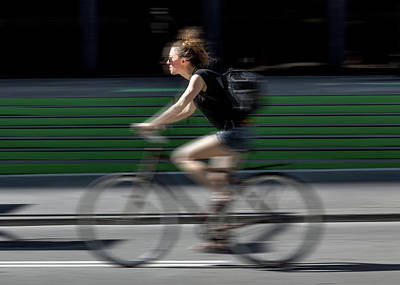 Photograph - Random Cyclist No 1 Color Blur Version by Brian Carson