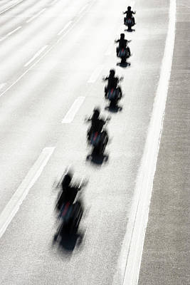 Photograph - Rear View Of Row Of Motorcycle Riders by Jorg Greuel