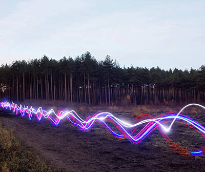 On The Move Photograph - Red, Blue And White Light Trails On by Tim Robberts
