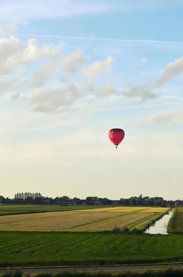 Rotterdam Photograph - Red Hot Air Balloon Above Polder Field by Photo By Ira Heuvelman-dobrolyubova