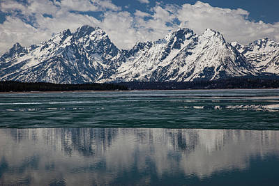 Photograph - Reflection In A Thawing Jackson Lake by Al Hann
