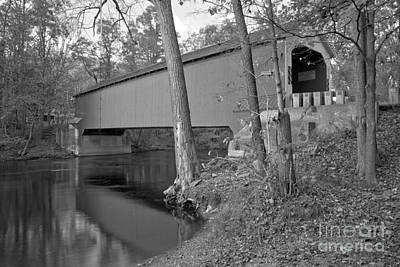 Photograph - Reflections Of The Eagleville Covered Bridge Black And White by Adam Jewell