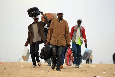 Photograph - Refugees Cross Tunisian Border To by Dan Kitwood