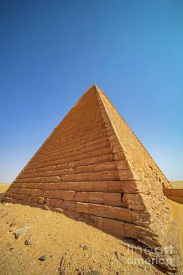 Thomas Kinkade - Restored pyramid in Meroe in the desert of Sudan shining in bright sunlight by Frank Heinz