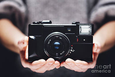 Grateful Dead - Retro camera in womans hands. Photography by Michal Bednarek