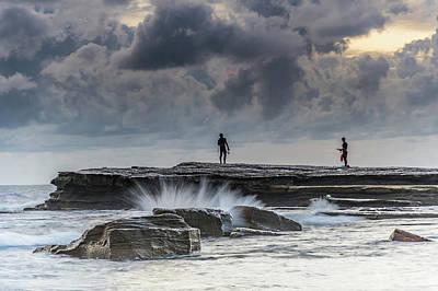 Rock Ledge, Spear Fishermen And Cloudy Seascape Art Print