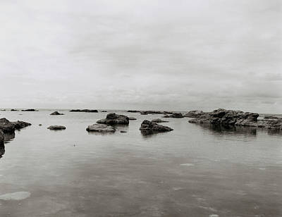 Photograph - Rocks In Calm Water by Toby Maudsley