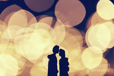 Photograph - Romantic Couple Kissing On Illuminated Background. by Michal Bednarek