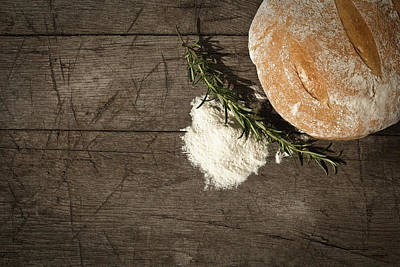 Photograph - Round Bread On A Wooden Table by Infrontphoto