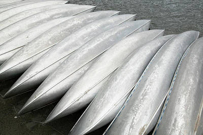 Photograph - Row Of Overturned Canoes by Richard Drury