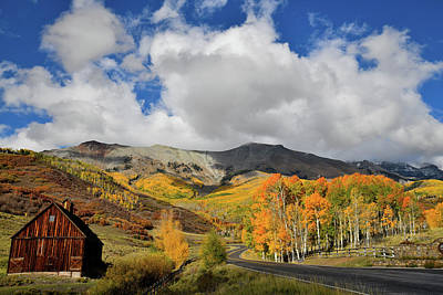 Photograph - Rustic Barn Beneath Aspen Covered Mountains by Ray Mathis