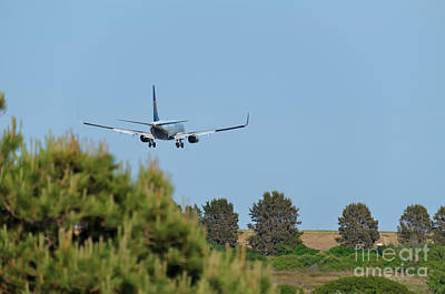 Photograph - Ryanair Plane Landing At Faro Airport by Angelo DeVal