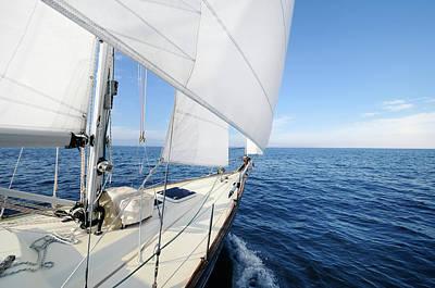 Recreational Boat Photograph - Sailing Towards The Horizon On A Sunny by Nikitje