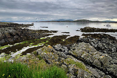Route 66 - Sand beach and rocky shore under clouds on Isle of Iona with boa by Reimar Gaertner