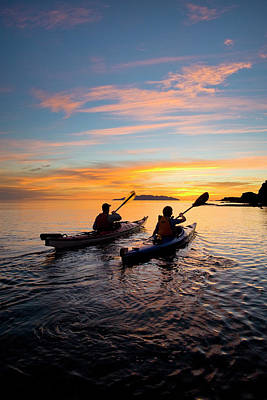 Photograph - Sea Kayakers Paddle Toward Sunrise, Sea by Danita Delimont