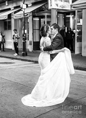 Photograph - Sealed With A Kiss On Bourbon Street New Orleans by John Rizzuto