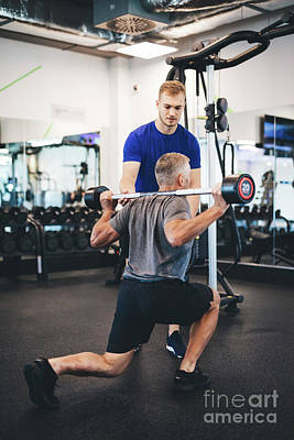 Photograph - Senior Man Exercising With Personal Trainer. by Michal Bednarek