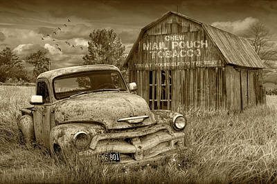 Photograph - Sepia Tone Of Rusted Chevy Pickup Truck In A Rural Landscape By A Mail Pouch Tobacco Barn by Randall Nyhof
