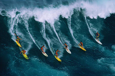 Standing Photograph - Seven Surfers Riding Large Wave by Warren Bolster