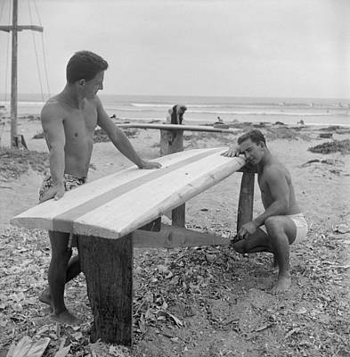 Photograph - Shaping Their Boards On The Beach by Loomis Dean