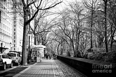 Photograph - Sidewalk Along Central Park New York City by John Rizzuto