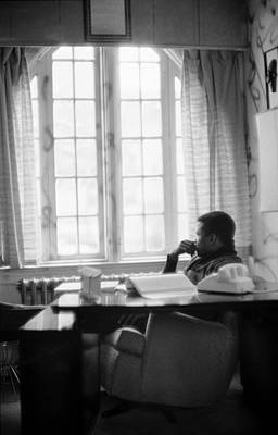 Human Interest Photograph - Sidney Poitier Looks Through A Window by Gordon Parks