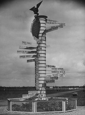 Photograph - Signpost At Schiphol Airport, Both Civil by William Vandivert