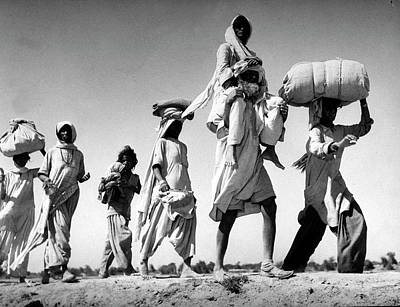 India Photograph - Sikh Carrying His Wife On His Shoulders by Margaret Bourke-white