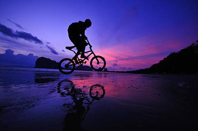 Photograph - Silhouette Of A Mountain Biker On Beach by Primeimages