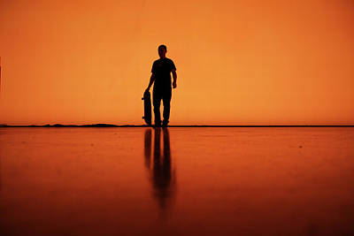 Photograph - Silhouette Of Man With Skateboard by Mgs