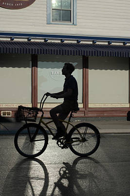 Photograph - Silhouette Young  Man On Bike In Front Of Store With Shadow by Dan Friend