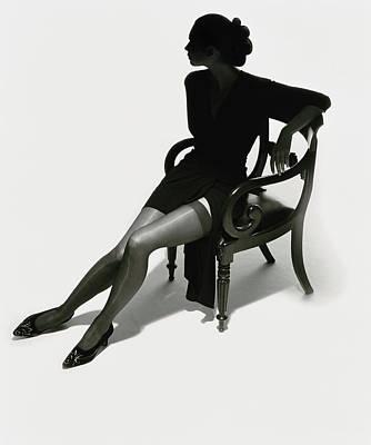 Silhouetted Woman On Chair Art Print by Tim Platt