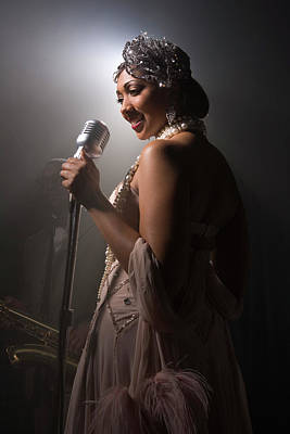 Photograph - Singer Performing In Nightclub by Jupiterimages