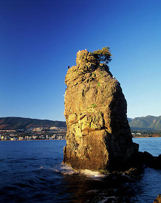 Photograph - Siwash Rock Is A Sea Stack Along The by Ron Erwin