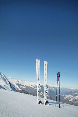 Ski Resort Photograph - Skis And Ski Poles Stuck In The Snow by L.a. Novia