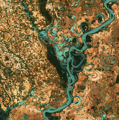 Marvelous Marble Rights Managed Images - Small, blocky shapes of towns, fields, and pastures surround the graceful swirls and whorls of the M Royalty-Free Image by Celestial Images