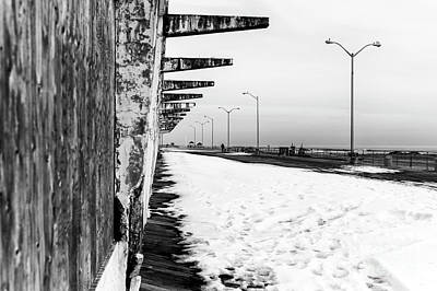 Photograph - Snow On The Boardwalk In Asbury Park by John Rizzuto