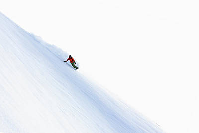 Photograph - Snowboarder Carving Turns Downhill by Christoph Jorda / Look-foto