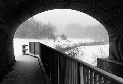 Photograph - Snowstorm through an archway by Diarmid Weir