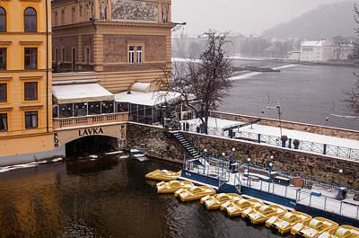 Photograph - Snowy Prague. Boats Dock At Smetana Museum by Jenny Rainbow