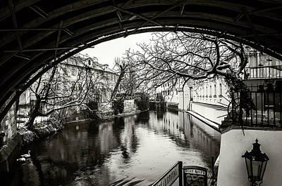 Photograph - Snowy Prague. Under Bridge Monochrome by Jenny Rainbow