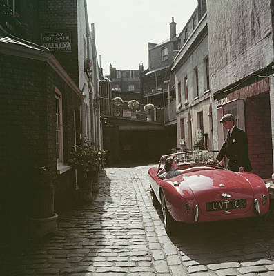 England Photograph - Sports Car Couple by Slim Aarons