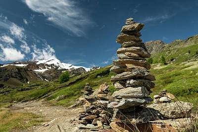 Thomas Kinkade - Stacked stones in Martell valley in South Tyrol on a sunny day in summer by Stefan Rotter