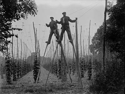 Photograph - Stilt Workers by Fox Photos