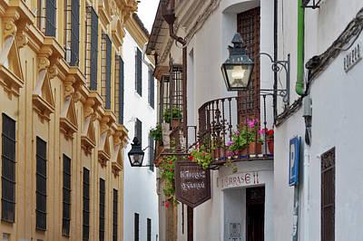 Balcony Photograph - Street And Flowered Balconies At Cordoba by Izzet Keribar